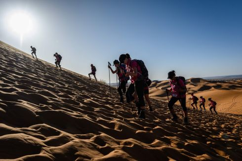 "ROSE TRIP MAROC: Women taking part in the ""Rose Trip Maroc"" desert trek climb up a sand dune in the Erg Chebbi region near Merzouga, Morocco. The female-only trek sees teams of three travel through the southern Moroccan Sahara desert. Photograph: Jean-Philippe Ksiazek/AFP/Getty"