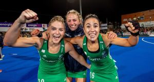 Ireland's Chloe Watkins, Hannah Matthews and Anna O'Flanagan celebrate qualifying for the 2020 Tokyo Olympics following their win over Canada in Energia Park, Donnybrook, on Sunday. Photograph: Morgan Treacy/Inpho