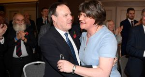 DUP deputy leader Nigel Dodds embraces party leader Arlene Foster during the DUP's recent annual conference. The North Belfast seat held by Dodds is likely to come under pressure due to a pro-remain election pact. Photograph: Michael Cooper/PA Wire.