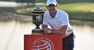 Rory McIlroy poses with his trophy after winning  the WGC-HSBC Champions tournament in Shanghai. Photograph: Hector Retamal/AFP via Getty Images.
