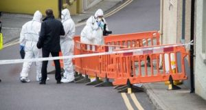 State Pathologist Marie Cassidy and Garda technical experts examine the scene in Skibbereen where John Ustic's body was found. Photograph: Provision