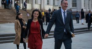 Dermot Shea leaves City Hall in New York with his wife, Serena, after being named commisioner of the New York Police Department – the largest police force in the United States. Photograph: Dave Sanders/The New York Times