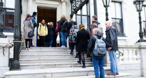 The queue to sign a book of condolence for broadcaster Gay Byrne in Dublin's Mansion House. Photograph: Tom Honan