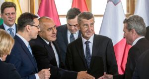 Poland's Mateusz Morawiecki, Bulgaria's Boyko Borisov and Czech Republic's Andrej Babis greet EU commissioner of digital economy and society Gunther Oettinger at the EU cohesion summit in Prague. Photograph: Michal Cizek/AFP