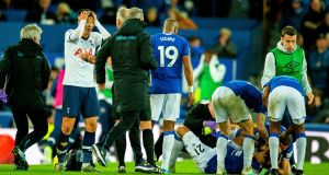 A distraught  Son Heung-min reacts after tackling Everton's André  Gomes which left the Everton player with a serious ankle injury. Photograph: EPA