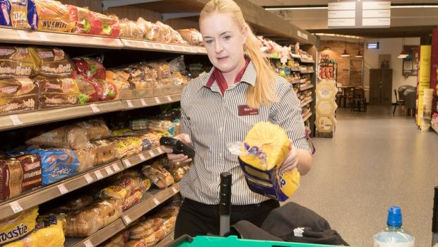 Marie McMahon scans all items picked for an order with 'the gun'. Photograph: Liam Burke/Press 22