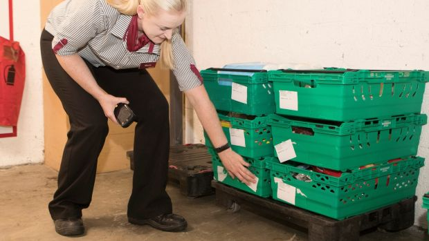 Marie McMahon codes the delivery boxes before loading them on the van. Photograph: Liam Burke/Press 22