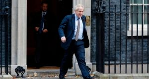 Boris Johnson leaves number 10 Downing Street  to meet with Britain's Queen Elizabeth II and request the dissolution of Parliament. Photograph:  Tolga Akmen