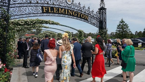 Though familiar in every sense, I'd never once walked through the famous gates of Flemington racecourse on Melbourne Cup day. Photograph: Scott Barbour/EPA