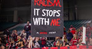 Portland Thorns supporters display a sign against racism in Oregon after their goalkeeper Adrianna Franch suffered racial abuse during an  away match in Salt Lake City, Utah. Photograph:  Diego Diaz/Icon Sportswire via Getty Images.