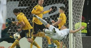 Vitoria's Bruno Duarte scores with an overhead kick against Arsenal. Photograph: AP