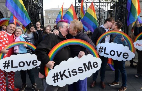 "SHIFT THE HATE: Sonya Mulligan and Ger Moane, of Drimnagh, with Philip Klubicka and Daniel Dudek (right) and Eddie McGuinness and Lynne Tracey (left), joining in a kiss outside the Dáil titled ""Shift the Hate Away"" in Dublin in protest at what they call a lack of hate crime legislation in Ireland. Photograph: Dara Mac Dónaill"