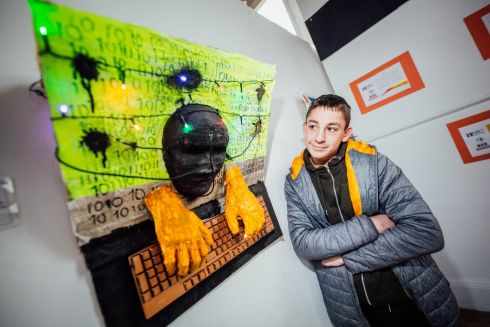 KEYBOARD WARRIOR: Calvin Ambrose with his art piece entitled Keyboard Warriors at the launch of an exhibition by students from St Canice's Special School in Limerick, at Mary Immaculate College, Limerick. Photograph: Brian Arthur