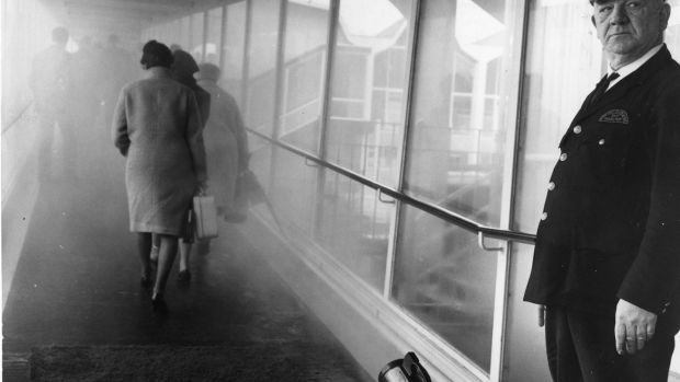 Passengers at Dublin Airport passing through a mist of disinfectant spray in 1967. Photograph: Gordon Standing