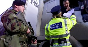 A garda requests a list of goods from a lorry driver at a checkpoint on the Dublin-Belfast Road at the Border in February 2001. Photograph: Ferran Paredes/Reuters