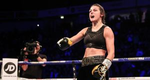 Katie Taylor celebrates her victory over Christina Linardatou after the super-lightweight championship fight at the  Manchester Arena. Photograph: Gary Carr/Inpho