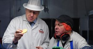 Boris Johnson checks a potato with quality control staff during a general election campaign visit to the Tayto Castle crisp factory in Co Armagh. Photograph: Daniel Leal-Olivas/Pool/AFP via Getty