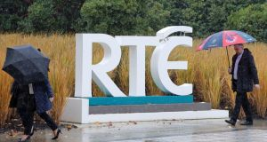 Rainy day: RTÉ workers at the company's headquarters at Donnybrook in Dublin. Photograph: Niall Carson/PA Wire