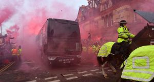 Manchester City's team bus is attacked before a Champions League game at Anfield in 2018. Photograph: Paul Ellis/Getty/AFP