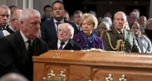 Michael D Higgins, his wife Sabina and Taoiseach Leo Varadkar, watch as the coffin of the celebrated broadcaster Gay Byrne, is carried into St Mary's Pro-Cathedral in Dublin. Photograph: Brian Lawless/PA Wire