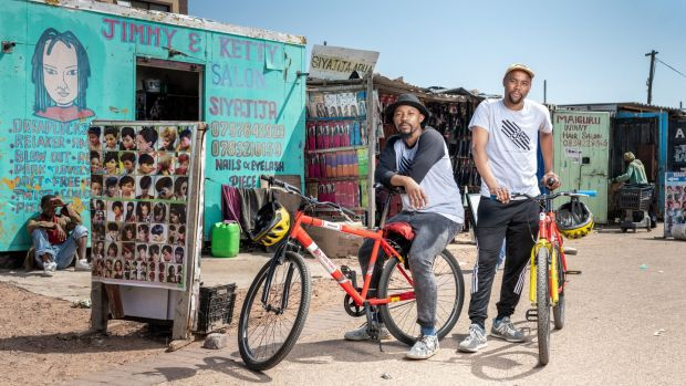 Ayanda Cuba and Buntu Matole, who have a bike tour business in Khayelitsha township near Cape Town. Photograph: Thom Pierce