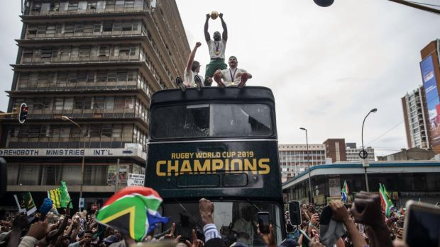 South African rugby captain Siya Kolisi ) holds up the Web Ellis trophy as the team parades through the streets of Johannesburg on Thursday. Photograph: Michele Spatari/AFP via Getty Images