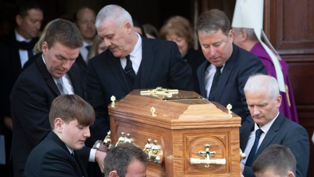 Gay Byrne's remains are carried from St Mary's Pro-Cathedral in Dublin following his funeral service. Photograph: Colin Keegan, Collins Dublin