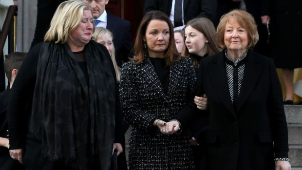 Kathleen Watkins (right), wife broadcaster Gay Byrne with their daughters Crona (left) and Suzy leaving St Mary's Pro-Cathedral in Dublin following his funeral service. Photograph: Brian Lawless/PA Wire