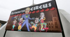 An image on the back of Free Derry Corner in the Bogside depicting UK prime minister Boris Johnson holding DUP puppets on strings. Photograph: Margaret McLaughlin