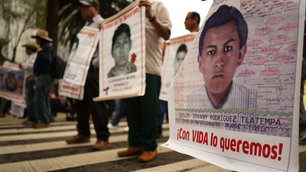 Photographs of some students from the Ayotzinapa college in Guerrero who disappeared in September 2014. Photograph: Eoin Wilson