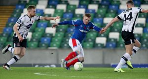 Linfield's Shayne Lavery in action against Seán Hoare and Andy Boyle of Dundalk during the first leg of the Unite the Union Champions Cup at Windsor Park. Photograph:  Brian Little/Inpho