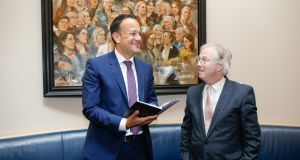 Eamonn Mallie and Taoiseach Leo Varadkar talking about the  journalist's poetry collection, Under The Tilley Lamp.