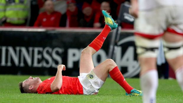 Munster's JJ Hanrahan goes down with an injury during the Guinness Pro 14 game against Ulster at Thomond Park. Photograph: Dan Sheridan/Inpho