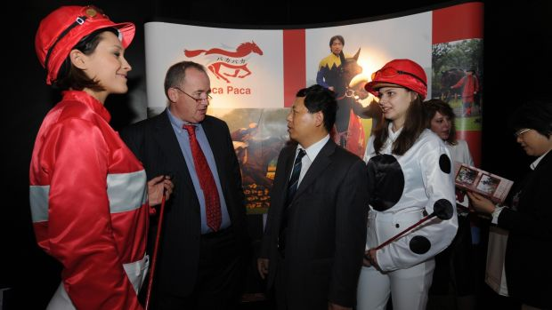 Irish horse racing entrepreneur Harry Sweeney talks with a Chinese businessman about race horse investment at a luxury goods fair in Shanghai, China. Photograph: Mark Ralston/AFP/Getty