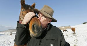 Harry Sweeney, owner of Paca Paca Farm, kisses Love And Bubbles, mare of the Japanese Derby winner Deep Brillante, at his farm in Hidaka, Hokkaido, Japan.  Photograph:  Kyodo News Stills via Getty Images