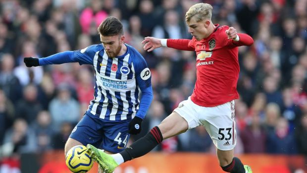 Brandon Williams tackles Ireland's Aaron Connolly during Manchester united's win over Brighton. Photograph: Nigel Roddis/EPA