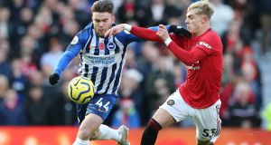 Aaron Connolly challenges for the ball with Manchester United's Brandon Williams. Photograph: Nigel Roddie/EPA