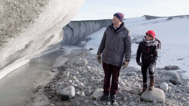 Gerald Fleming observes Greenland's melting ice sheet up close; it could translate into sea-level rise of up to 40cm by 2050. Photograph: Midas Productions