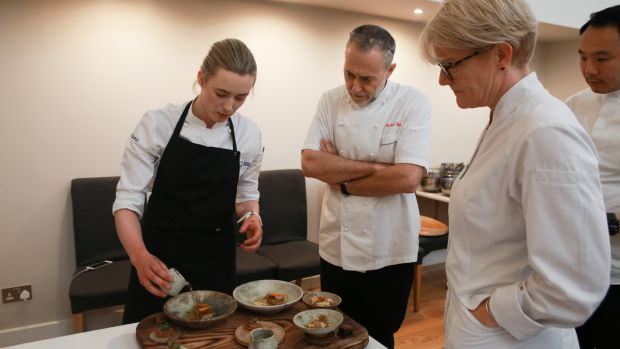Euro-Toques Ireland young chef winner Gráinne Mullins presenting her dishes to judges Michel Roux junior (centre) and Margot Janse.