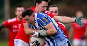 Ballyboden's Ryan Basquel is tackled by Thomas Costello of Newtown Blues. Photograph: Oisin Keniry/Inpho