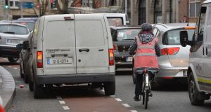 Cars blocking the cycle lane on a Dublin street. Photograph: Alan Betson