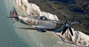 A second World War Spitfire flies over the White Cliffs of Dover in Kent in a tribute to the fallen on Remembrance Day. Photograph: Gareth Fuller/PA