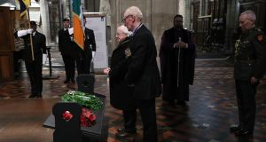 President Michael D Higgins with Lieut Col Ken Martin during the Remembrance Sunday service at St Patrick's Cathedral, Dublin. Photograph: Nick Bradshaw