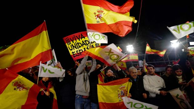 Supporters of Spanish far-right Vox party celebrate outside the party's headquarters in Madrid on Sunday. Photograph: Oscar Del Pozo/AFP via Getty Images