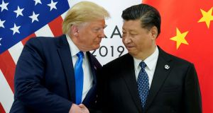 US President Donald Trump meets with China's President Xi Jinping: Th US and China have agreed in principle to phase out tariffs imposed in the ongoing trade war.  Photograph: Kevin Lamarque/Reuters