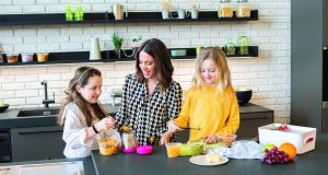 Mummy Cooks founder Siobhan Berry with her daughters Ashleigh (10) and Jessica (8). Teach the whole family the importance of reducing food waste by getting everyone involved
