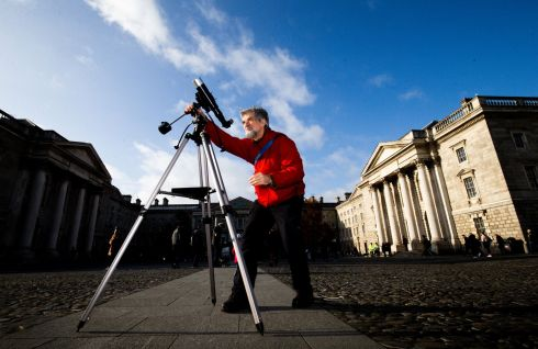 MERCURY MOVING: Prof Brian Espey from Trinity College Dublin observes the transit of Mercury across the Sun using a solar telescope. Astrophysicists from Trinity invited the public to view the smallest planet using high-powered telescopes. Photograph: Tom Honan