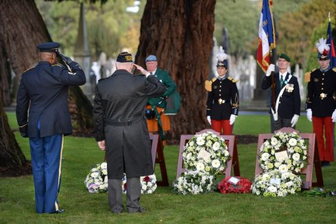 ARMISTICE DAY: John Shanahan, American Legion (right) and Eric Taylor, Sergeant First Class, US Army, salute after laying a wreath for Irish soldiers of the first World War during the Armistice Day Commemoration in Glasnevin Cemetery, Dublin. Photograph: Dara Mac Donaill