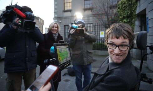 CASE SETTLED: Connor Corroon pictured outside the Four Courts on Monday after a High Court action. The 24-year-old, who has cerebral palsy, received a settlement of €17.5m over the circumstances of his birth at a Cork hospital. Photograph: Collins Courts