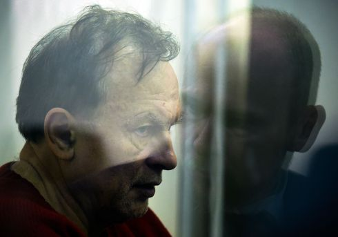 ST PETERSBURG MURDER: Oleg Sokolov stands behind glass as he attends a court hearing in Saint Petersburg, after he confessed to the murder and the dismembering of his former student lover. The 63-year-old history lecturer was arrested on November 9th on suspicion of murder after he was hauled out of the icy Moika River with a backpack containing a woman's arms. Photograph: Olga Maltseva/AFP/Getty